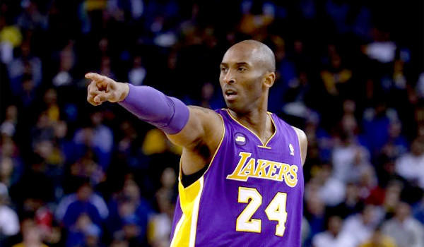 Kobe Bryant returned to practice Tuesday for the Lakers and passed the ball more than usual. Bryant hopes to practice again on Wednesday and Thursday and that could put him on target to make his season debut Friday at Sacramento.