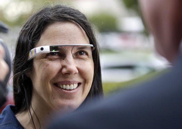 Cecilia Abadie wears her Google Glass as she talks with her attorney outside San Diego traffic court. Abadie pleaded not guilty to speeding and distracted driving for wearing the Google Glass.