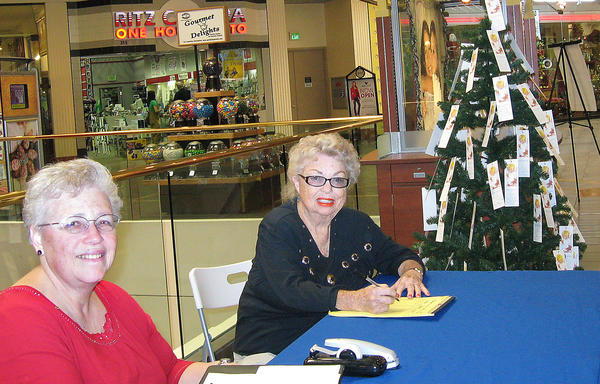 Volunteers at the Salvation Army Angel Tree are Cookie Bentivegna, left, and Barbara Marks at the Burbank Town Center.