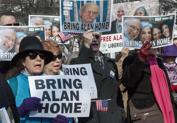 Supporters rally on behalf of Alan Gross, who has been in a Cuban prison for four years, during a rally in Lafayette Park in Washington, D.C.