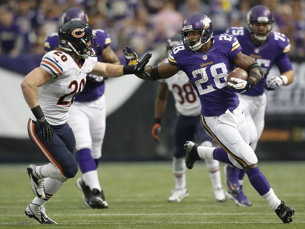 Vikings running back Adrian Peterson is pushed out of bounds by Craig Steltz in the second quarter.