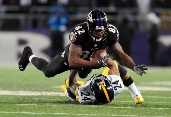 Ravens wide receiver Torrey Smith is brought down by Steelers cornerback Ike Taylor on Thursday night.