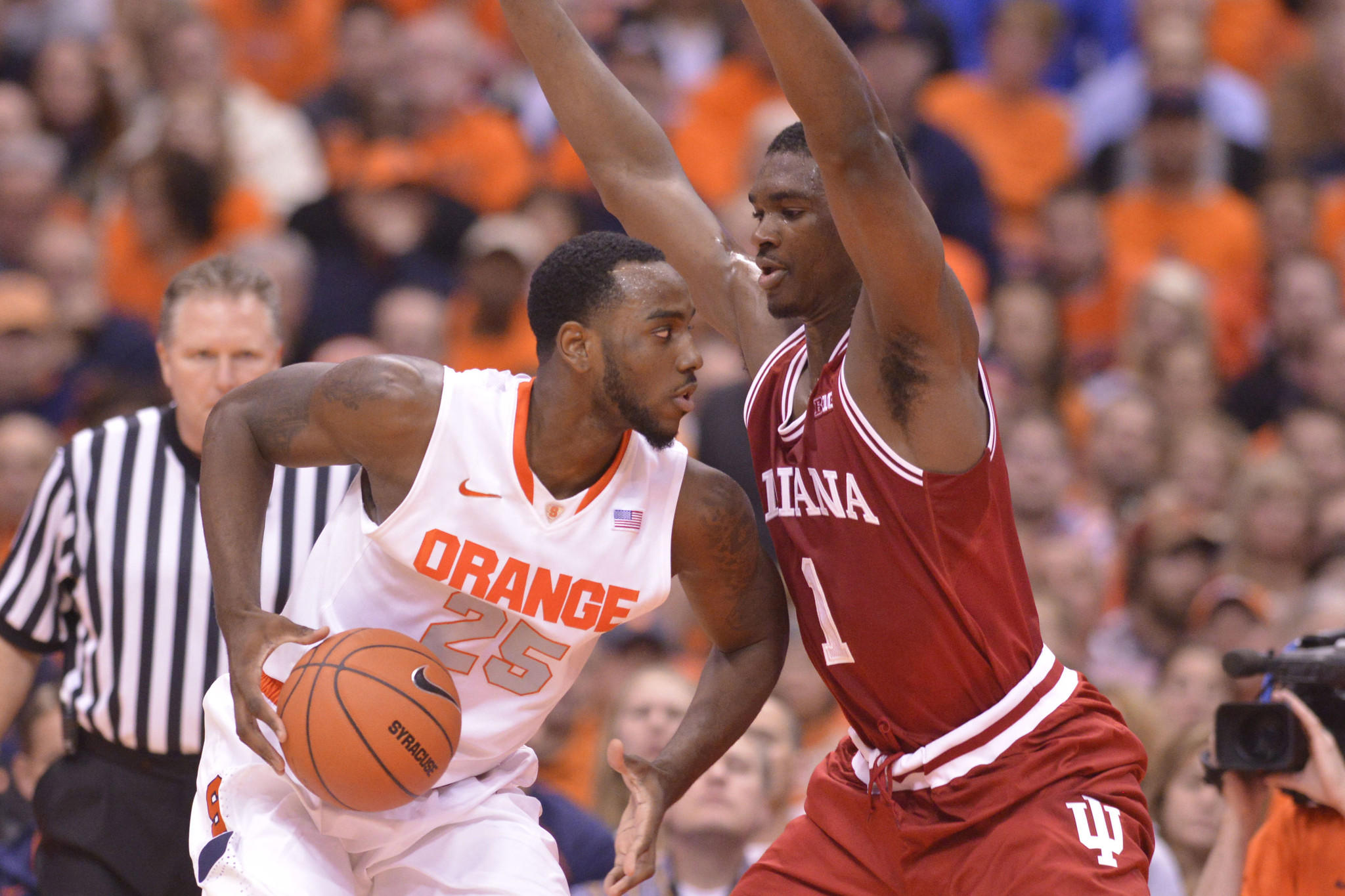 Syracuse's Rakeem Christmas dribbles the ball as Indiana's Noah Vonleh defends during the first half.