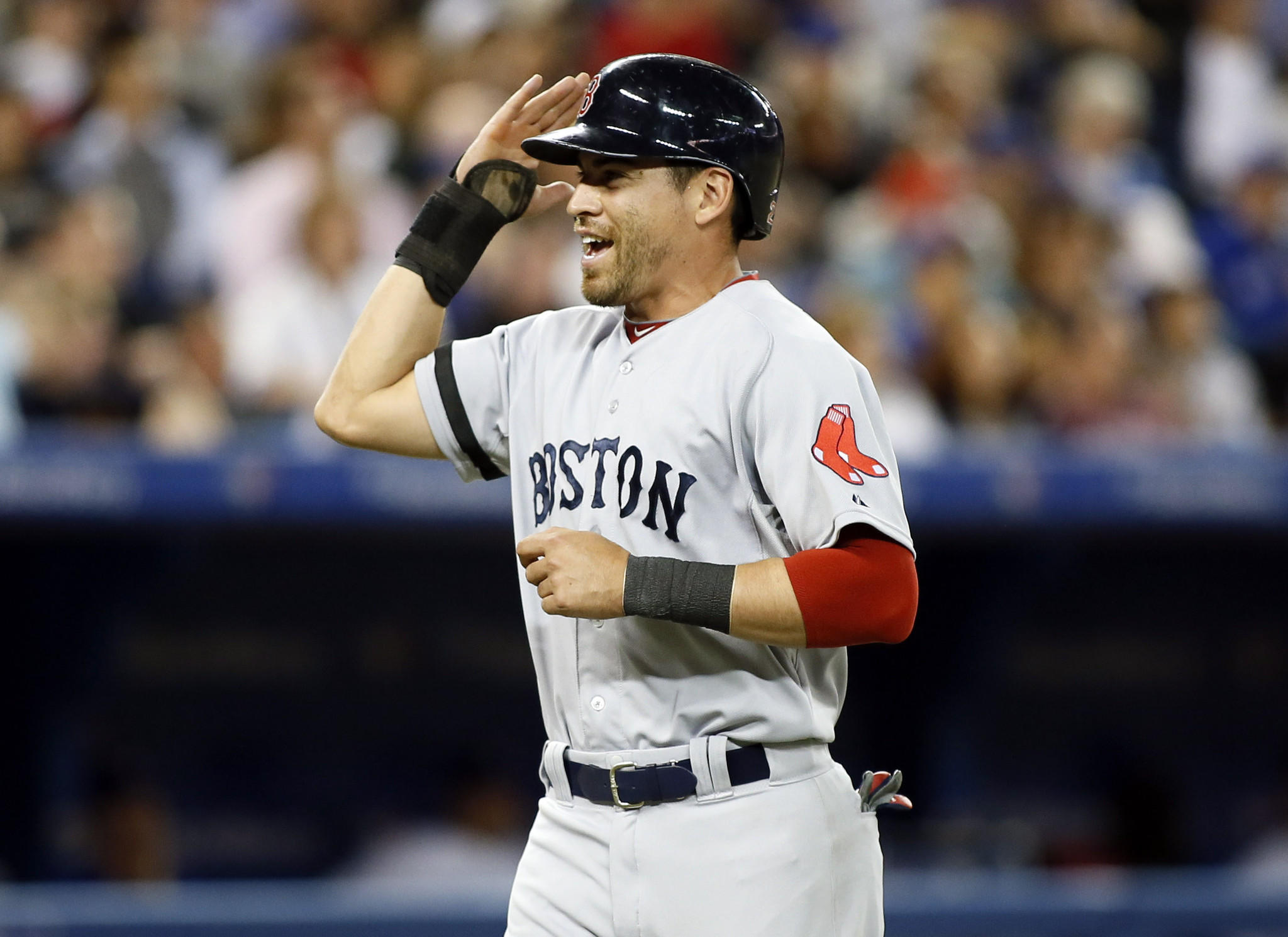 Red Sox center fielder Jacoby Ellsbury reacts after scoring a run in the seventh inning against the Blue Jays.