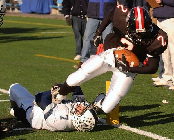 Northern Lehigh's Pete Wayda has a hold of Aliquippa's Darrelle Revis, but the future NFL star is able to dive into the end zone during the PIAA Class 2A championship game on Dec. 7, 2003