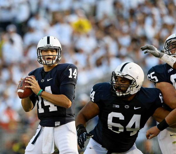 Penn State quarterback Christian Hackenberg (14) looks to pass against Michigan during first half action at Beaver Stadium on Saturday, October 12, 2013.