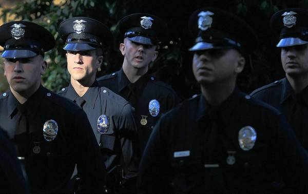 New recruits assemble for their graduation exercises at the Los Angeles Police Academy. The LAPD has seen a decline in qualified applicants over the last several months, and officials fear the department will remain understaffed if the decline continues.