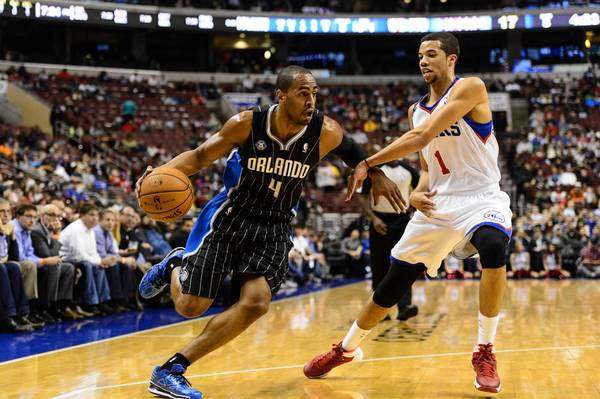 Dec 3, 2013; Philadelphia, PA, USA; Orlando Magic guard Arron Afflalo (4) is defended by Philadelphia 76ers guard Michael Carter-Williams (1) during the first quarter at the Wells Fargo Center. **