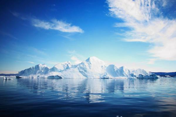An iceberg floats off Greenland. Climate scientists say that among the changes already underway are the sudden decline in Arctic sea ice and climbing extinction rates.