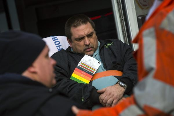 Metro-North engineer William Rockefeller Jr. is loaded into an ambulance after a train derailment in the Bronx borough of New York on Dec. 1, 2013.