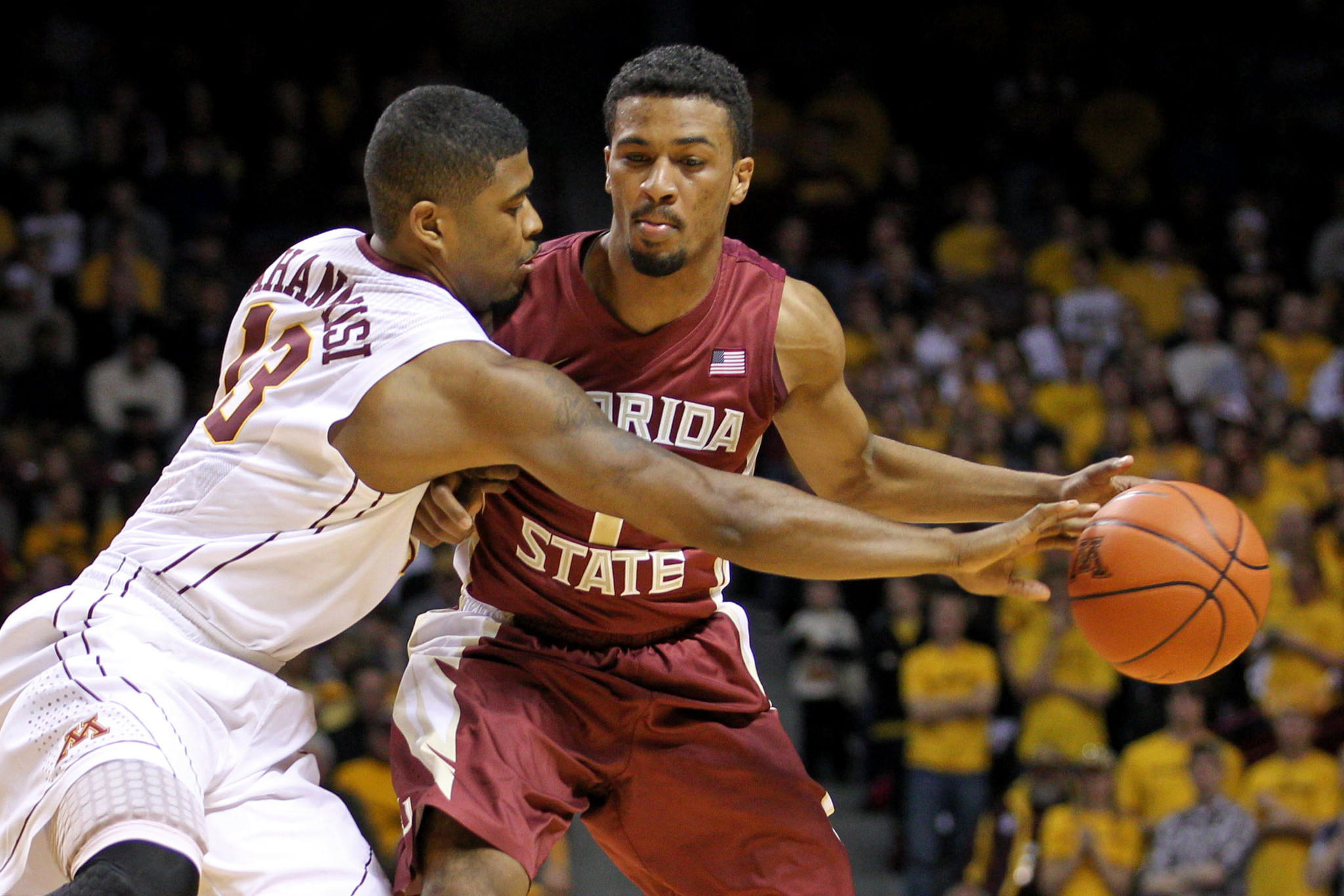 Minnesota's Maverick Ahanmisi pokes the ball away from Florida State's Devon Bookert during the first half.