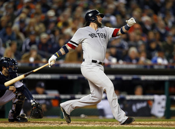 Oct 16, 2013; Detroit, MI, USA; Boston Red Sox catcher Jarrod Saltalamacchia (39) hits an RBI single against the Detroit Tigers during the fifth inning in game four of the American League Championship Series baseball game at Comerica Park.
