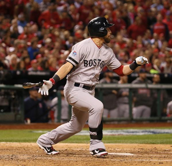 Boston Red Sox's Jacoby Ellsbury drives in a run with a single in the seventh inning against the St. Louis Cardinals during Game 5 of the World Series at Busch Stadium in St. Louis, Missouri, on Monday, October 28, 2013.