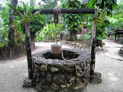 The botanical gardens in the Chankanaab Beach Park in Cozumel feature replicas of Mayan ruins, such as this well.