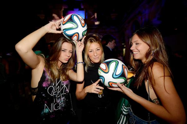 RIO DE JANEIRO, BRAZIL - DECEMBER 03: Guests with Brazuca ball during the adidas Brazuca launch at Parque Lage on December 3, 2013 in Rio de Janeiro, Brazil. Brazuca is the Official Match Ball for the FIFA World Cup 2014 Brazil. Tonight adidas revealed brazuca to the world in the stunning setting of Parque Lage in Rio de Janeiro. The reveal was part of a spectacular light projection supported by global footballers Seedorf, Hernane and FIFA World Cup Winner Cafu. Hundreds of guests and celebrities were treated to this one off experience, which launched the Official FIFA World Cup Ball for Brazil 2014. For more information visit: news.adidas.com/worldcupOMB (