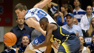 10th-ranked Duke celebrated a 79-69 win over No. 22 Michigan on Dec. 3 at Cameron Indoor Stadium.