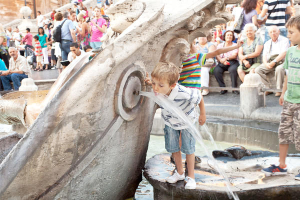 Young-at-heart travelers, like this boy in Rome, make their own fun wherever they go.