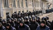 Ukraine opposition blocks work in parliament, vows continued protests