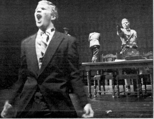 Prime Minister Hasting, played by Matt Morris, is about to get shot by Col. Buckingham, played by Andrew Engler in this scene from the December 2003 St. Francis High School presentation of William Shakespeare's Richard III, a version that was set in 1939.