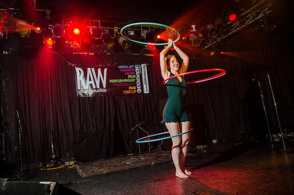 """Sylvi"", hoop dancer, participates in the August RAW showcase."