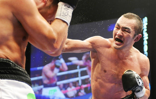 Beibut Shumenov, right, throws a punch during his victory over Enrique Ornelas in June. Shumenov is looking to make a name for himself as a professional boxer.