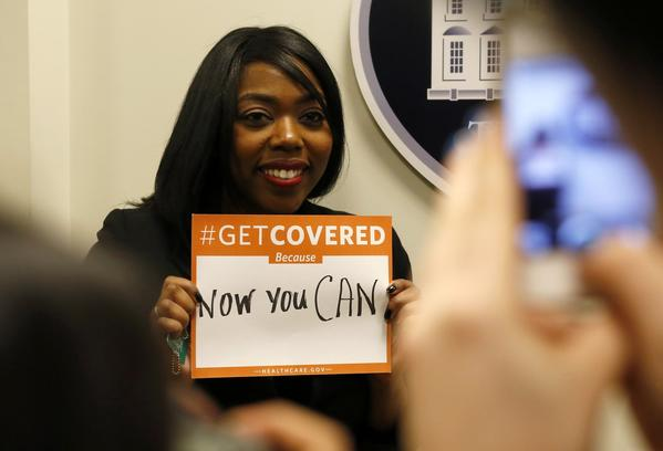 A woman poses for photos at the White House Youth Summit on the Affordable Care Act in Washington on Wednesday.