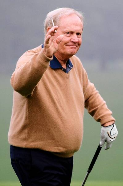 Honorary starter Jack Nicklaus waves to patrons after he tees off to start the first round of the 2013 Masters Tournament at Augusta National Golf Club on April 11.