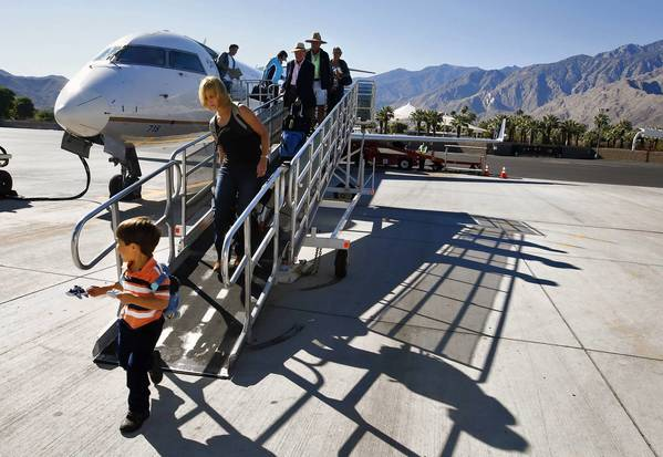 Local officials say that Coachella Valley tourism and Palm Springs, the one-time Hollywood party town that has remade itself into a trendy destination, have fueled the surge in airport traffic. Above, passengers disembark from a flight with Mt. San Jacinto in the background.