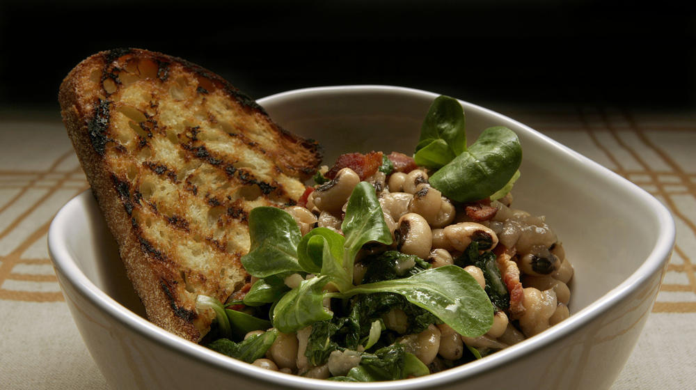 Warm salad of black-eyed peas, wilted mustard greens and bacon