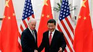 Biden holds lengthy talks in Beijing amid China air zone dispute