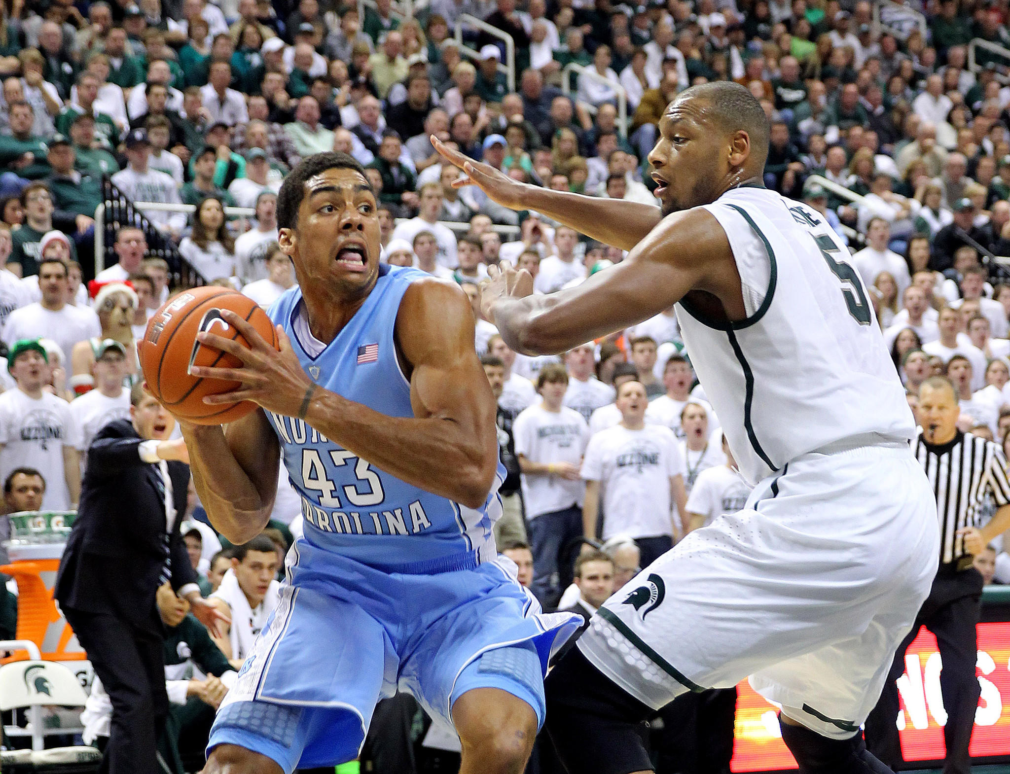 North Carolina's James Michael McAdoo drives the baseline against Michigan State's Adreian Payne during the first half.