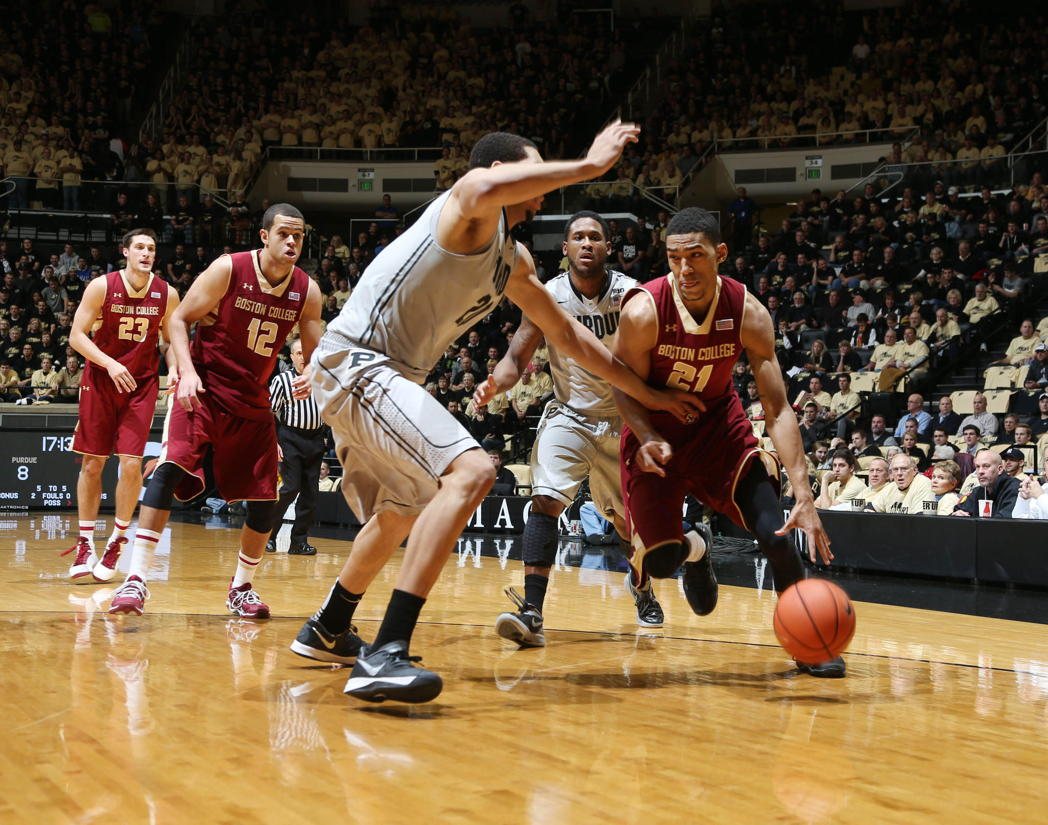 Boston College's Olivier Hanlan drives to the basket against Purdue's Terone Johnson and A.J. Hammons at Mackey Arena.