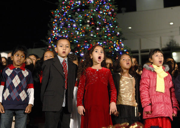 Students from Cerritos Elementary School sing Christmas songs at the lighting of the Christmas tree at Parcher Plaza at Glendale City Hall on Wednesday, December 4, 2013. (Tim Berger/Staff Photographer)