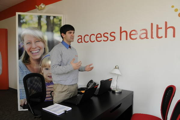Outreach worker Luke Bajana stands inside Access Health CT's newly opened storefront in New Britain. The state health care exchange, operating under the federal Affordable Care Act, is hosting an enrollment fair in Manchester on Dec. 14.