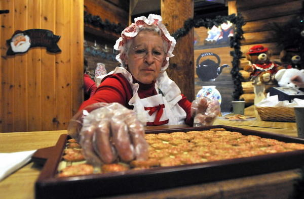 Mrs. Claus puts cookies out for the kids at the 31st annual Santa's Workshop last year at the log cabin at Wickham Park in Manchester.