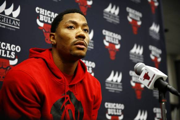 Derrick Rose listens to a question Thursday during a news conference at United Center.