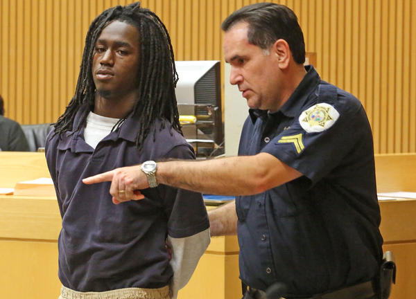J'Morian Bell, 17, arrives in juvenile court Thursday, December 5, 2013 for his initial court appearance. J'Morian Bell was arrested Wednesday for shooting fellow student Ja'Roderick Smith during a fight after school at the bus loop.