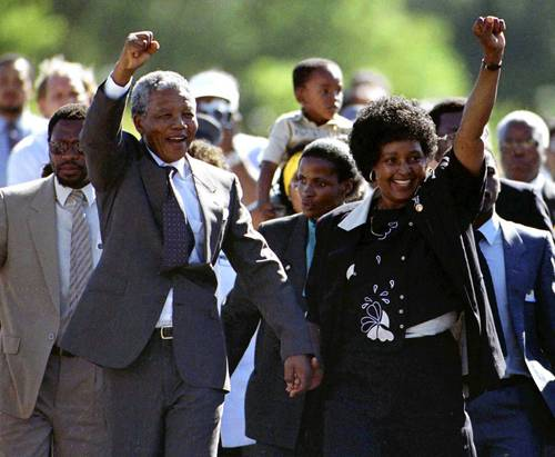 Nelson Mandela, left, accompanied by his wife Winnie, walks out of the Victor Verster prison in February 1990, near Cape Town, after spending 27 years in apartheid jails.