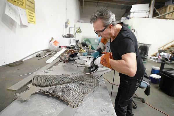 "Artist Ron Taybi works on the head piece of his ballerina metal sculpture ""Gracious - Beacon of Peace"" in his Irvine workshop. The piece will be shipped to Sochi, Russia, for the Winter Olympics."