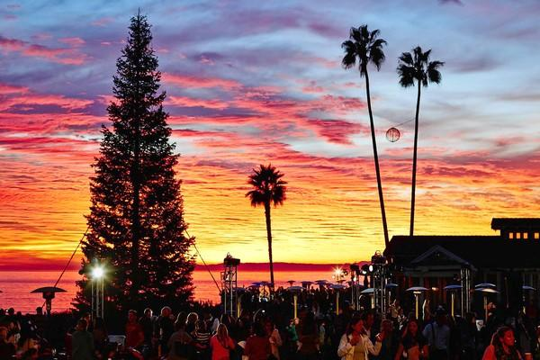 Guests enjoy a beautiful sunset at the Montage Laguna Beach during the fourth annual Tree Lighting Ceremony and Community Open House on Dec. 2.