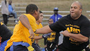 Navy tackles Army in spirited flag football game at Fort Meade