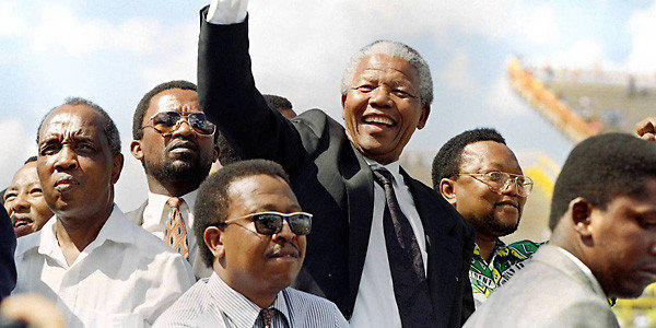 Nelson Mandela with supporters at an election rally in March 1994. (Walter Dhladhla, AFP/Getty)