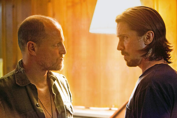 "Left to right: Woody Harrelson and Christian Bale star in Relativity Media's ""Out of the Furnace."""