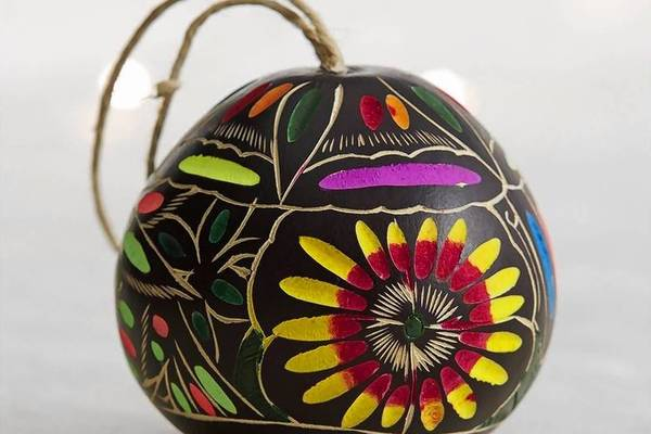 Global gourd ornament hand-carved and hand-painted in Peru