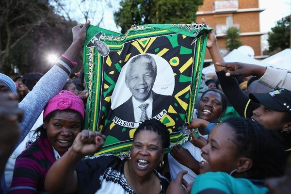 Supporters of Nelson Mandela gather in Pretoria, South Africa, where he was being treated for a lung infection in June. The former South African president died Thursday at the age of 95.