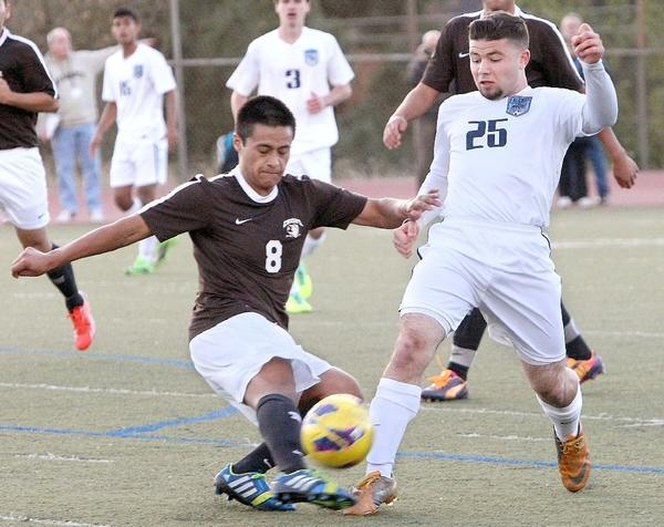 Crescenta Valley High's Tyler Hosepian battles for the ball with Crespi's Andre Morales during a nonleague match at Crescenta Valley High on Thursday. The Falcons won, 2-1. (Roger Wilson/Staff Photographer)