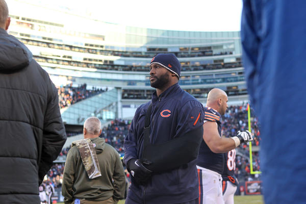 Injured linebacker Lance Briggs walks along the sideline at Soldier Field.