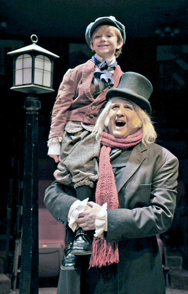 "Jaymes Hale plays Tiny Tim and Daniel Roebuck is Ebenezer Scrooge in Glendale Centre Theatre's ""A Christmas Carol."""