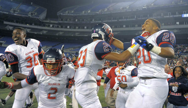 Franklin's Kiandre Murphy (30), Marquis Miller (2), Jordan Adams (23) and Maurice McFadden (20) rejoice as time expires.