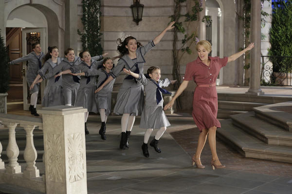 (L-r) Michael Nigro as Friedrich, Ella Watt-Gorman as Louisa, Joe West as Kurt, Sophia Anne-Caruso as Brigitta, Grace Rundhaug as Marta, Ariane Rinehart as Liesl, Peyton Ella as Gretl, Carrie Underwood as Maria.